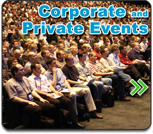 Private and Corporate shows button - photo of large audience seated in an auditorium